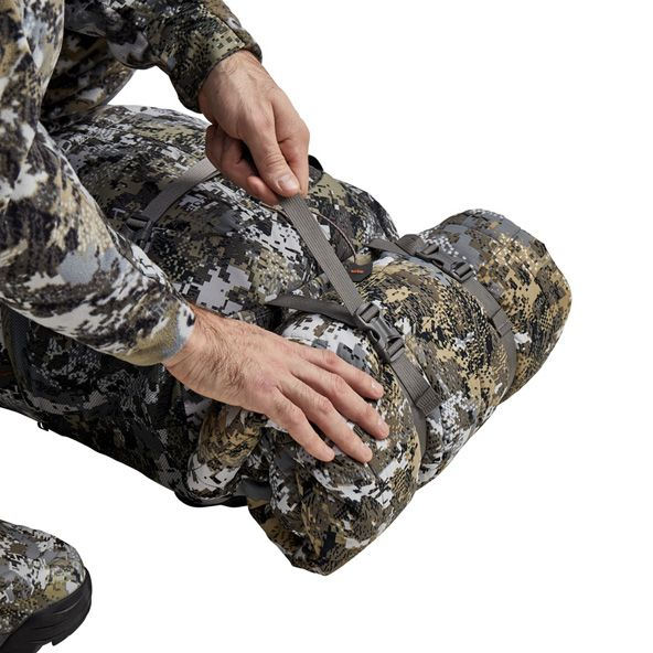 Tool Bucket Whitetail Pack compressing jacket onto pack
